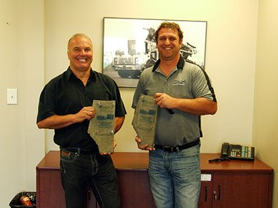 members of the Dynamic Concrete Pumping team holding the award for the 2013 Award of Excellence in the Advanced Concrete Construction category