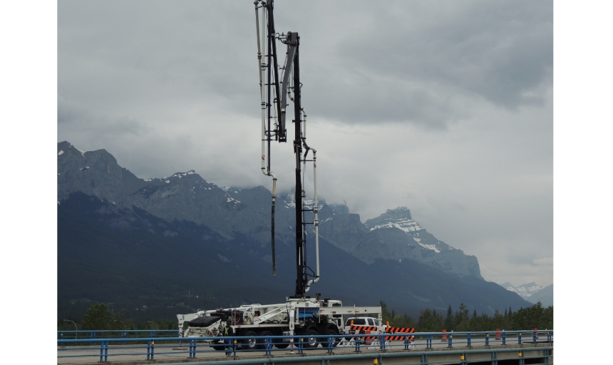 Dynamic Concrete Pumping working to fix roads and bridges after a flood in Alberta