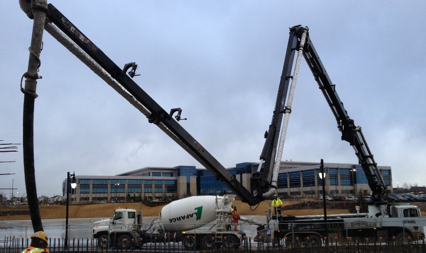 Dynamic Concrete Pumping working on the Quarry Park Development project in front of a building