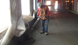 Dynamic Concrete Pumping concrete finisher using equipment on a job