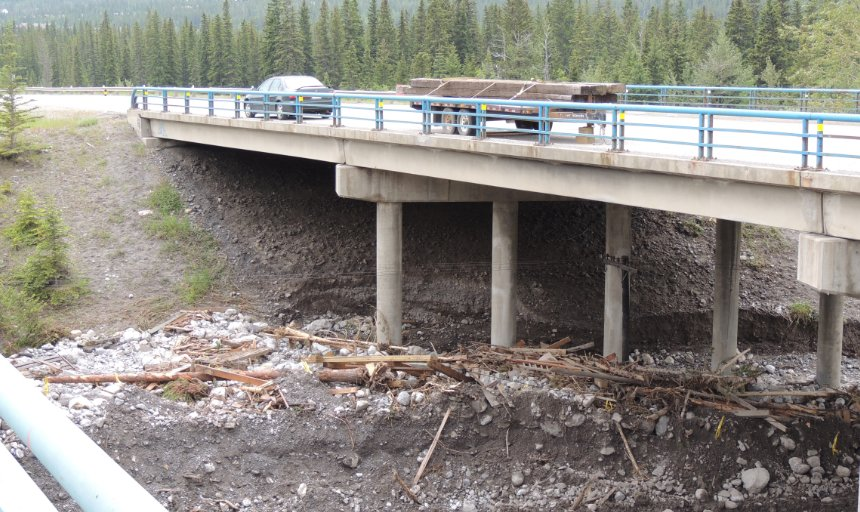 area under bridge washed out after a flood in Southern Alberta