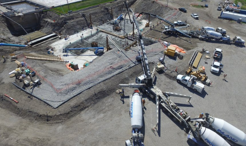 multiple Dynamic Concrete Pumping trucks working on the water treatment plant project