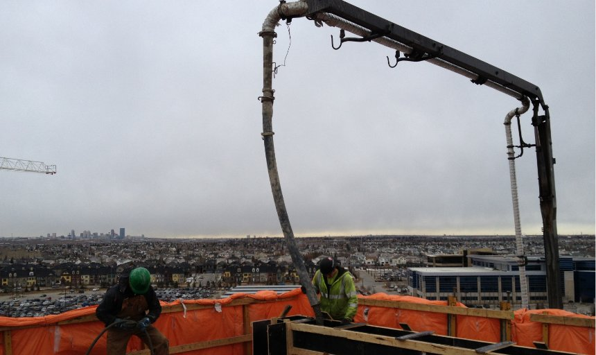 two heavy equipment operators from Dynamic Concrete Pumping on the Quarry Park Development job