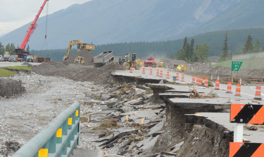 construction workers fixing a washed out road in Southern Alberta