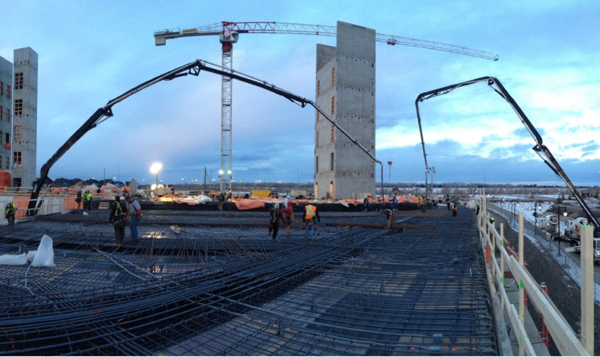 Dynamic Concrete Pumping working in the early morning on the Quarry Park Development project