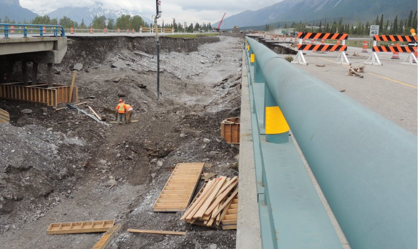 construction workers working on the roads and bridges after a flood in Southern Alberta