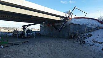 Dynamic Concrete Pumping 33-M concrete boom pump at work on a job