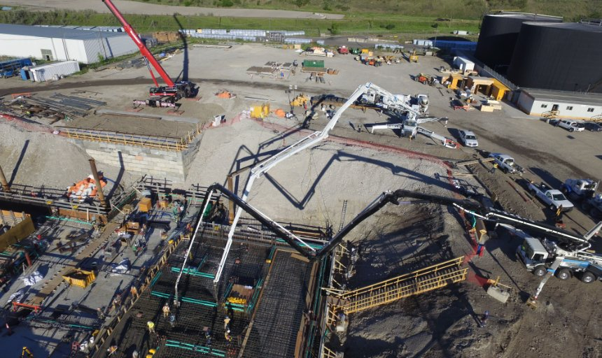 multiple boom pumps from Dynamic Concrete Pumping working on the water treatment plant job