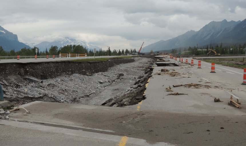 road washed out by floods in Southern Alberta