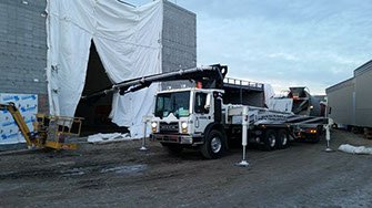 Dynamic Concrete Pumping utilizing their 33 meter concrete boom pump on a project