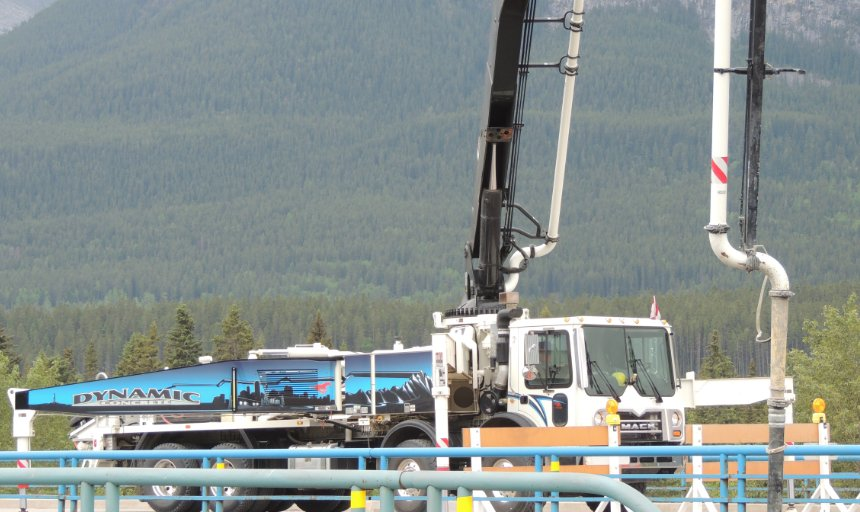 Dynamic Concrete Pumping concrete truck pumping concrete on the Trans-Canada, Canmore job