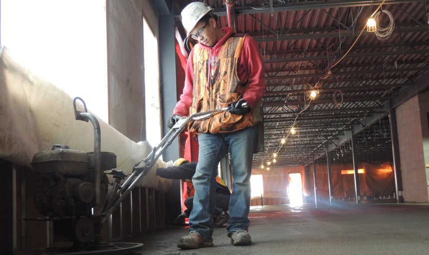 Dynamic Concrete Pumping concrete finisher using equipment while working on a job