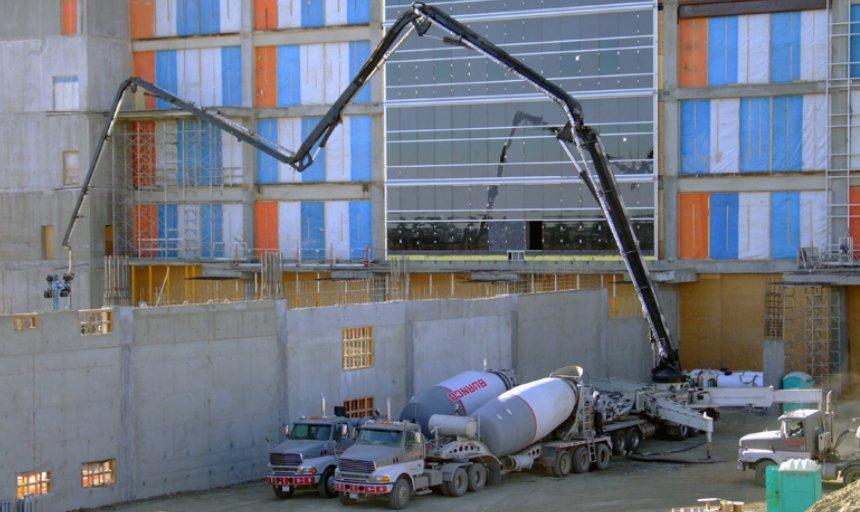 Dynamic Concrete Pumping utilizing a large concrete boom pump to pump concrete at the Calgary South Hospital project