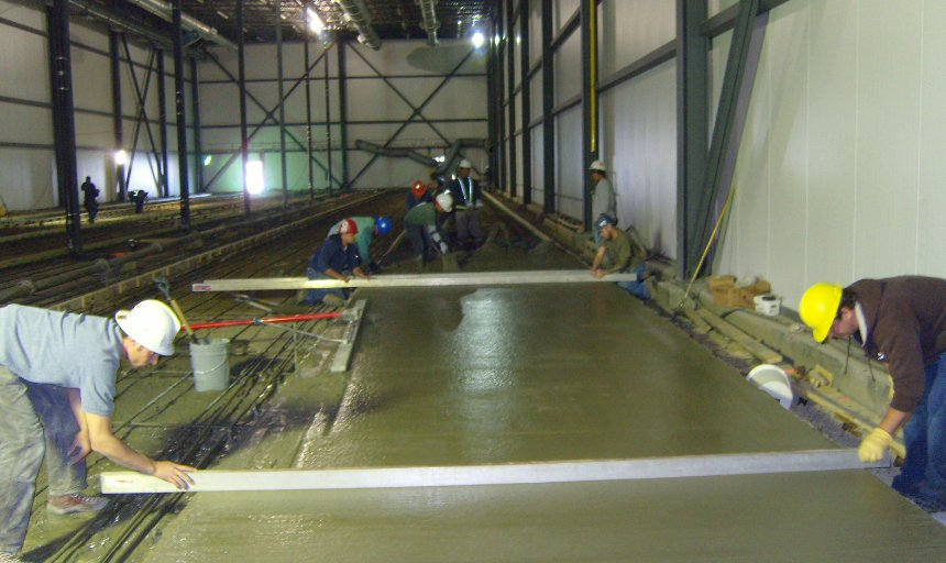 Dynamic Concrete Pumping contractors working on a superflat floor