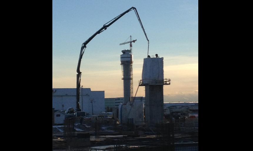 Dynamic Concrete Pumping boom pump reaching to pump concrete on a job site