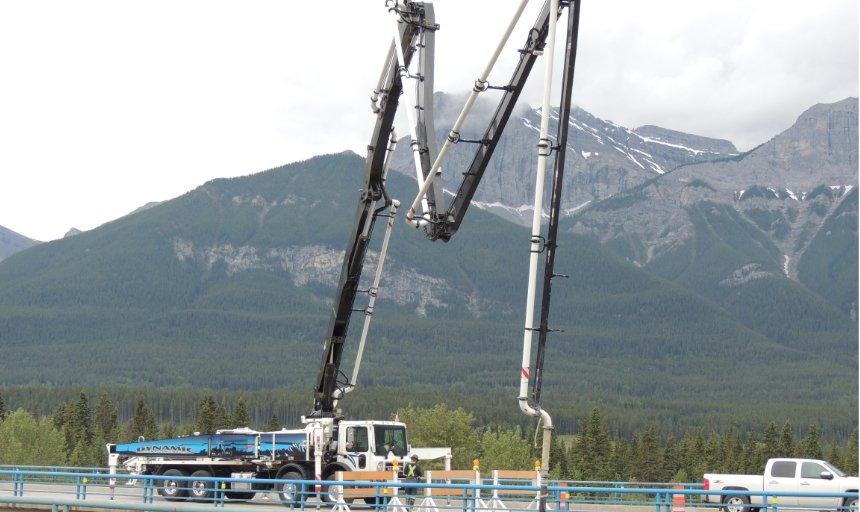 Dynamic Concrete Pumping working to fix roads and bridges after a flood