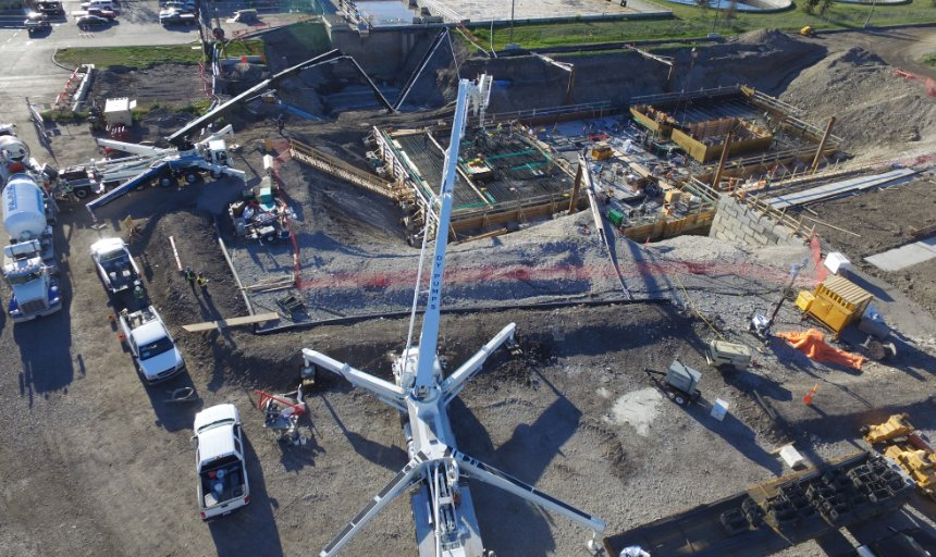 two concrete boom pumps being used to complete a Dynamic Concrete Pumping job