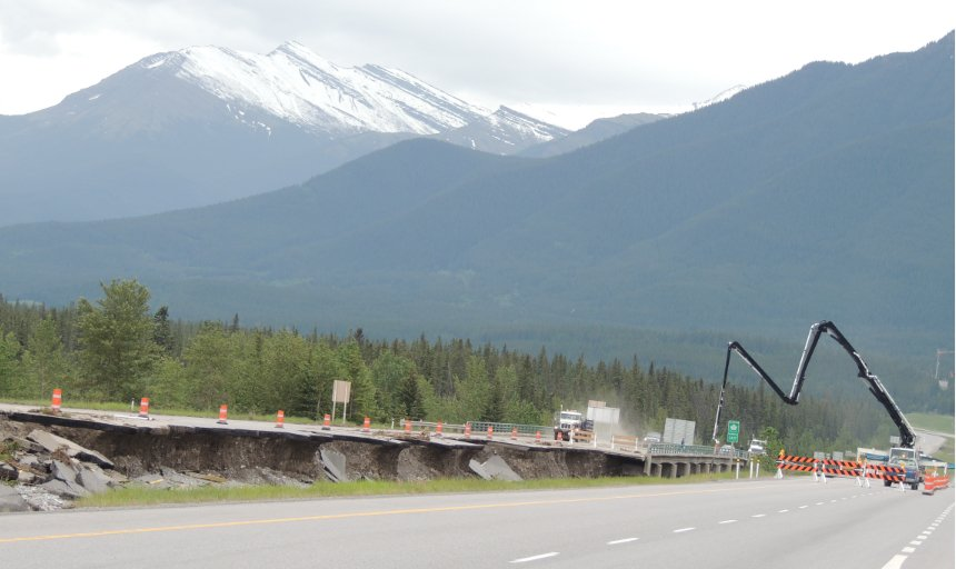Dynamic Concrete Pumping using a single boom pump on the Trans Canada, Canmore job, in front of a mountain and trees