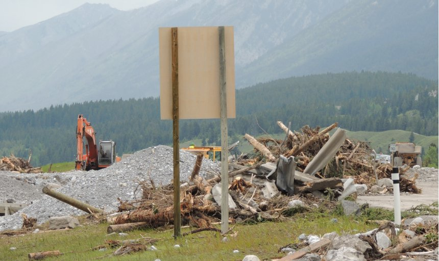 broken trees, guard rails, and rocks at the Trans Canada, Canmore job site