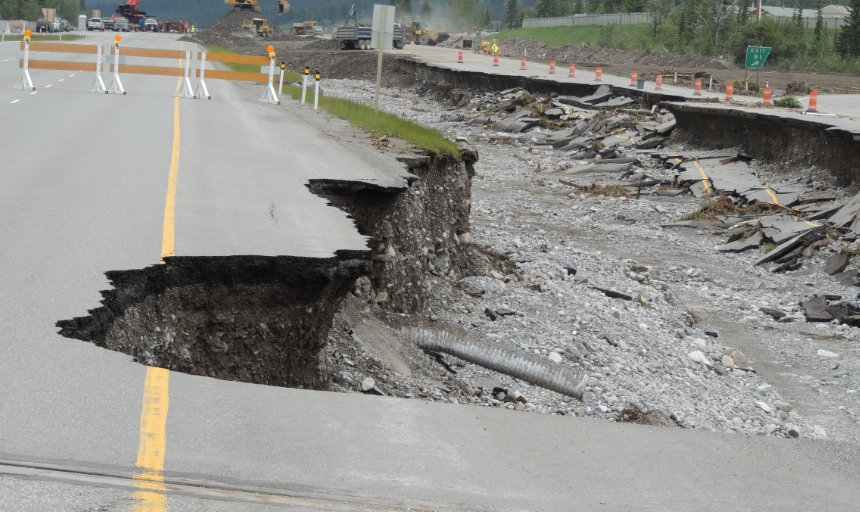 road washed out by floods at the Trans Canada, Canmore job site