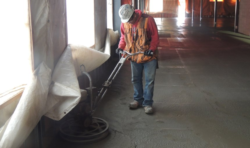 concrete finishing contractor completing a Dynamic Concrete Pumping project using a piece of equipment