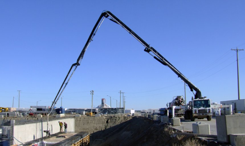 concrete boom pump reaching to pump concrete at the Calgary South Hospital project
