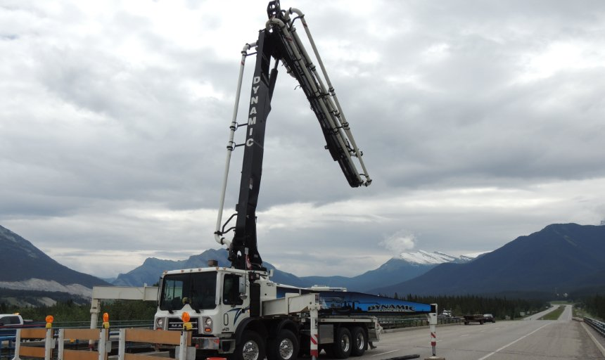 Dynamic Concrete Pumping pump unfolding at the Trans Canada, Canmore job site