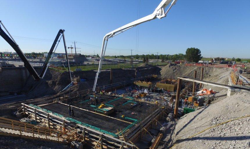 concrete boom pumps adding concrete to the Water Treatment Plant project