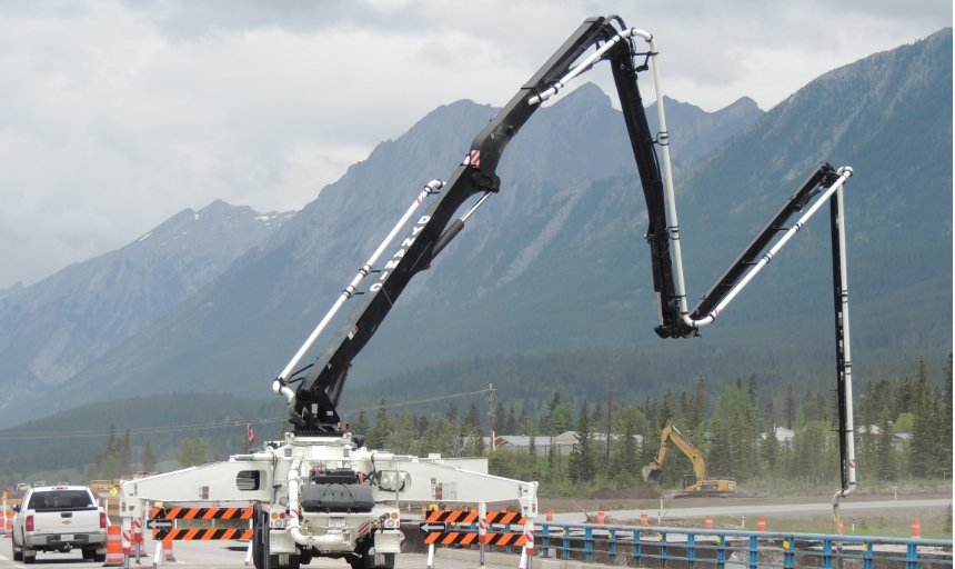 one of Dynamic Concrete Pumping pumps being used to add concrete at the Trans Canada, Canmore project