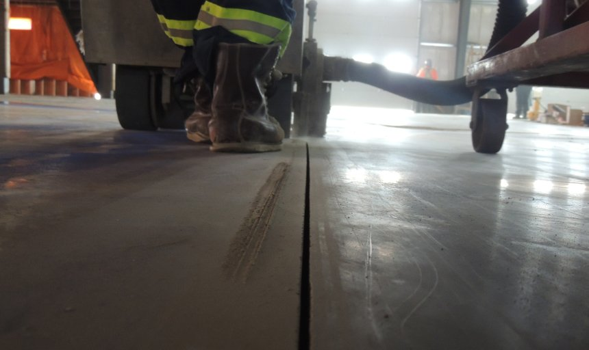 Dynamic Concrete Pumping contractor using a concrete cutting machine on a job