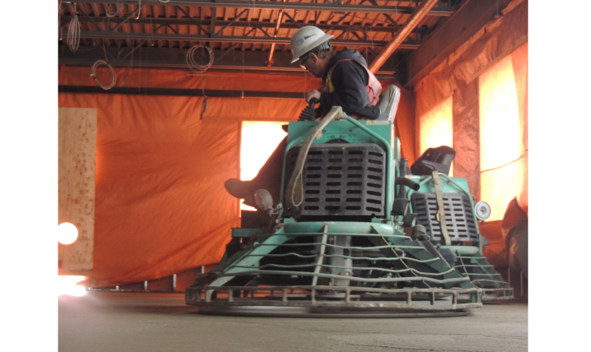 Dynamic Concrete Pumping concrete finisher using equipment to complete a project