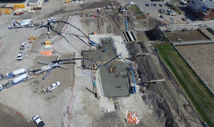 multiple Dynamic Concrete Pumping pump trucks working at the Water Treatment Plant project