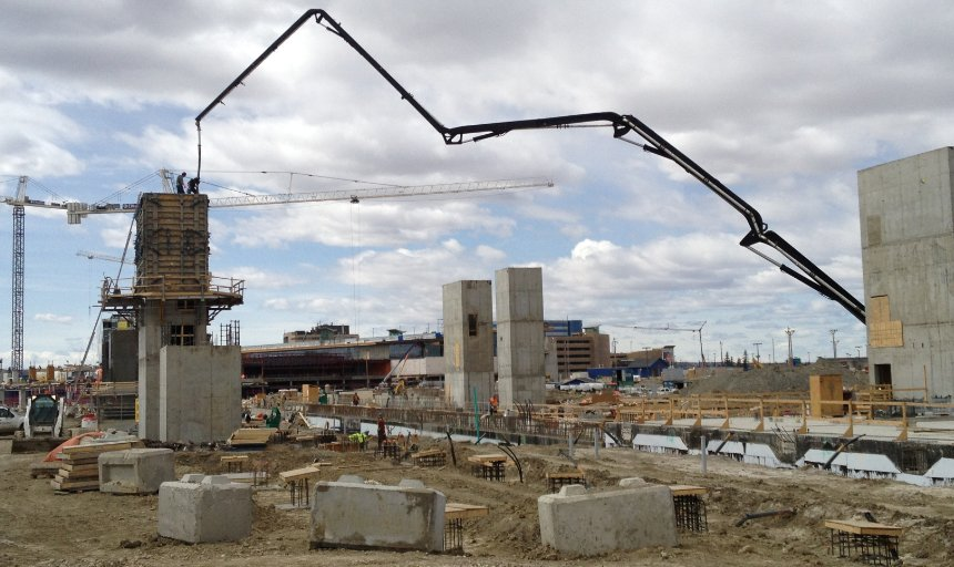 Dynamic Concrete Pumping boom pump extended while working on the Quarry Park Development project