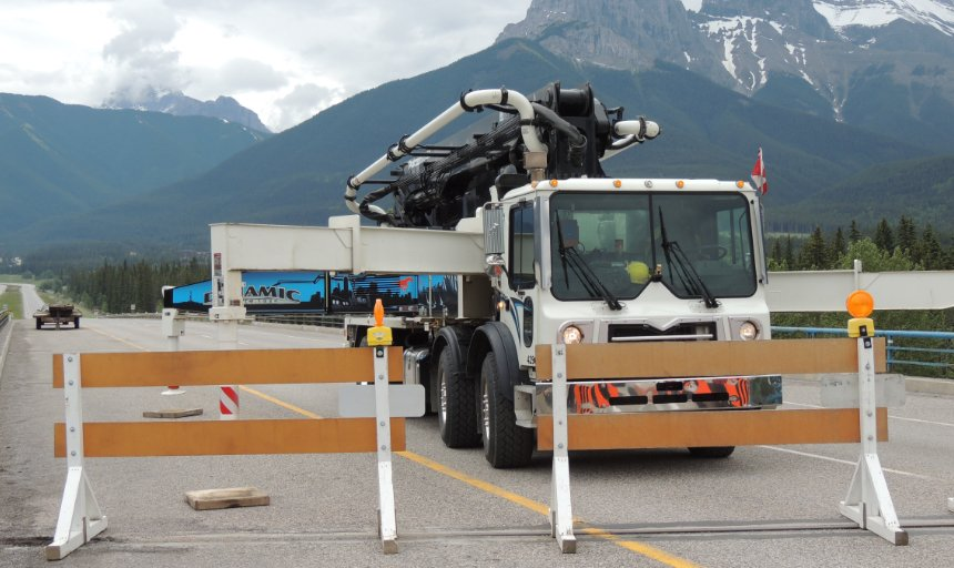 Dynamic Concrete Pumping truck behind roadblocks at the Trans Canada, Canmore project