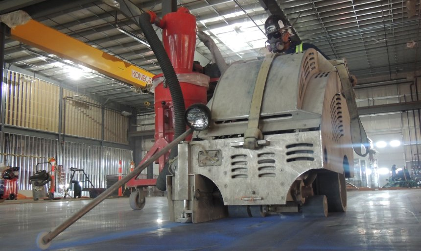 Dynamic Concrete Pumping contractor at work using a piece of soff-cutting machinery