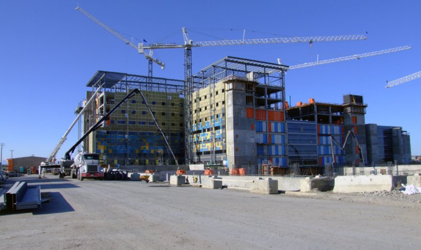 two Dynamic Concrete Pumping boom pumps being used at the Calgary South Hospital project