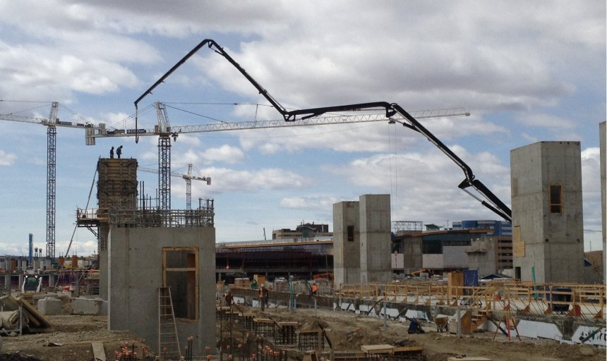 Dynamic Concrete Pumping boom pump extended and being used at the Quarry Park Development project