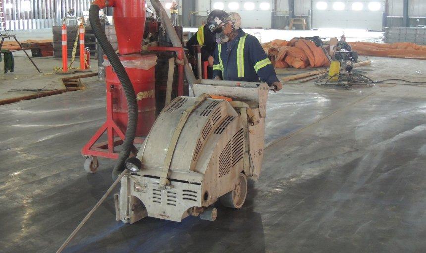 Dynamic Concrete Pumping employee working on a concrete cutting job
