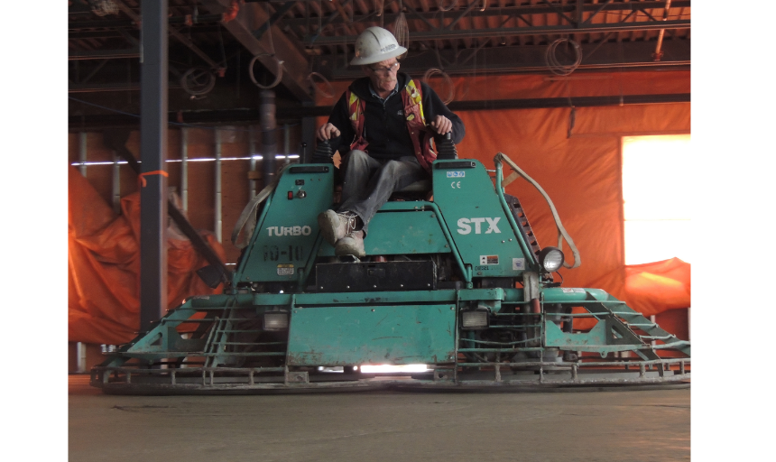 Dynamic Concrete Pumping finisher on a piece of concrete finishing equipment