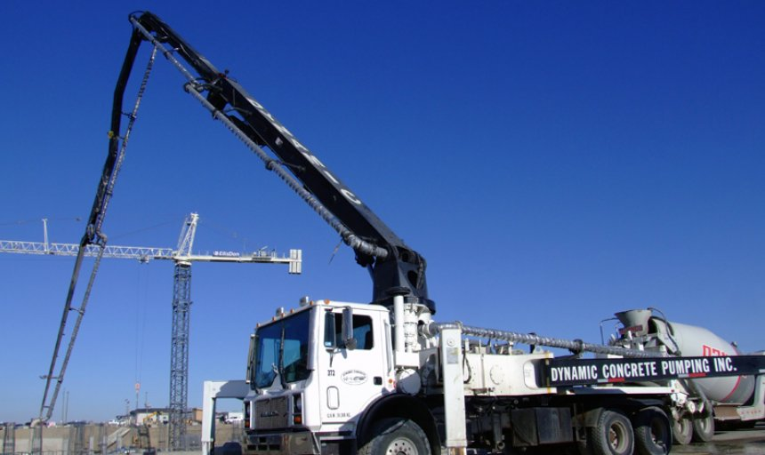 Dynamic Concrete Pumping boom pump being used at a job site