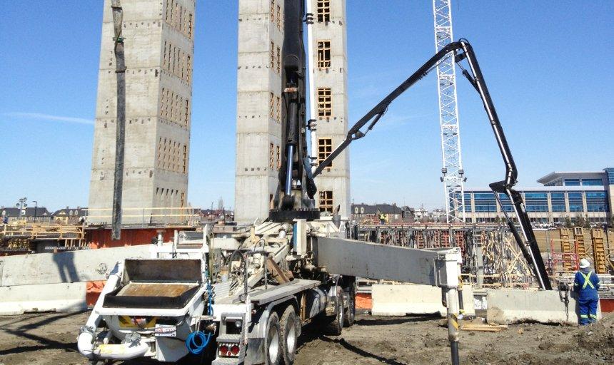 Dynamic Concrete Pumping boom pump adding concrete to the Quarry Park Development job
