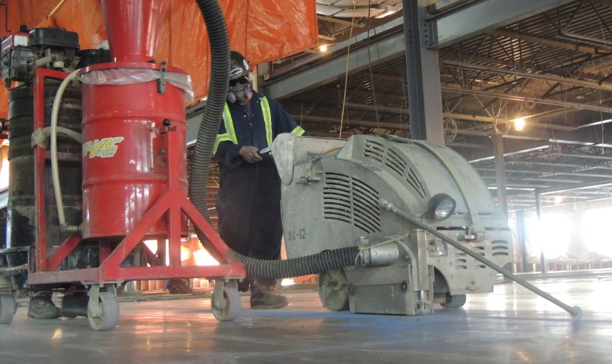 concrete contractor using a piece of soff-cutting equipment to complete a project