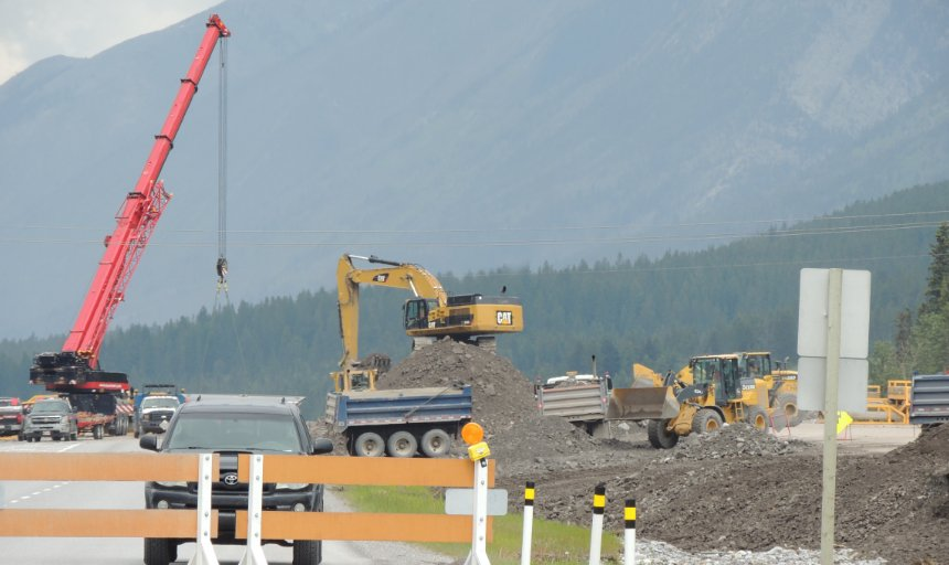 construction equipment and a crane being used on the Trans Canada, Canmore project