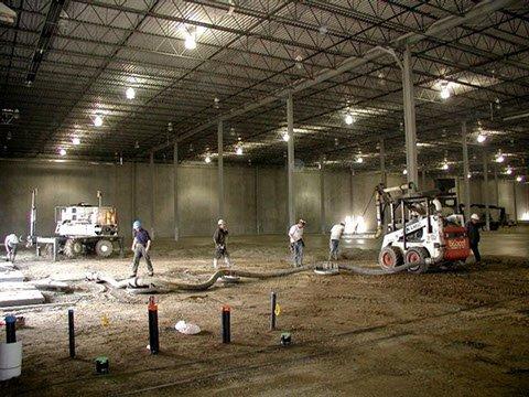 Dynamic Concrete Pumping using a Bobcat concrete placer at a job site