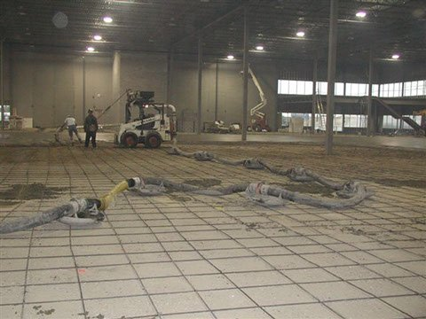 Bobcat concrete placer being used to place concrete on a Dynamic Concrete Pumping project