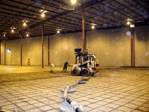 Bobcat concrete placer adding concrete to a floor