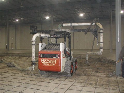 Bobcat concrete placer being used to add concrete on a Dynamic Concrete Pumping project