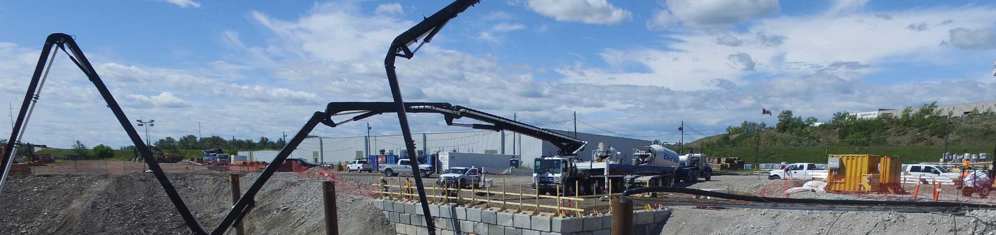 Dynamic Concrete Pumping boom pump being used on a project