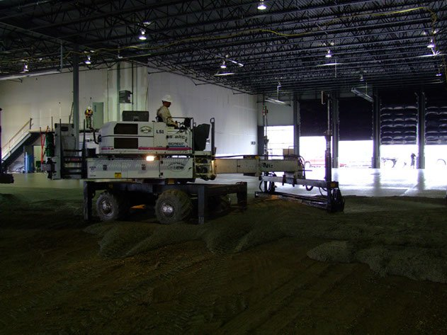 concrete contractor using laser screed equipment on a Dynamic Concrete Pumping project