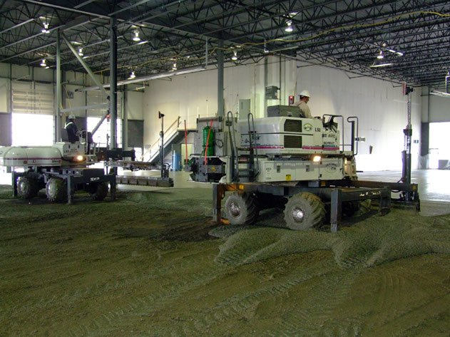 two pieces of laser screed equipment being used to complete a Dynamic Concrete Pumping project